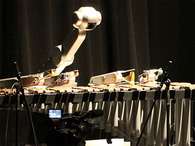 Shimon the robotic, improvising, and singing robot plays music with graduate students.