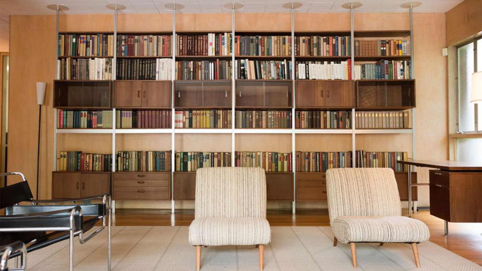 A photo of the custom-designed bookshelves in the living room of the Heffernan House on Georgia Tech campus.