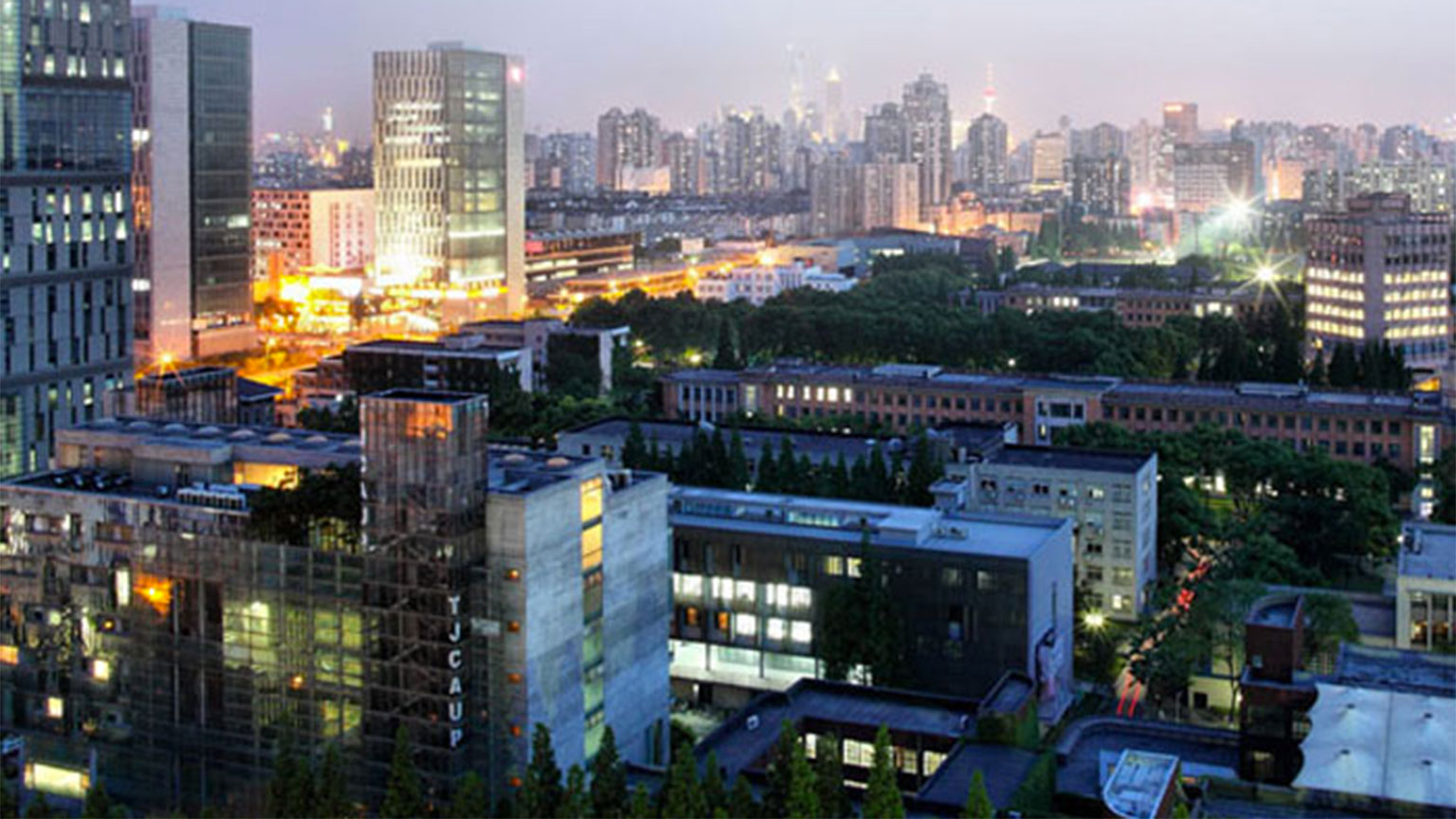 A photo of Tongee University in China, at night.