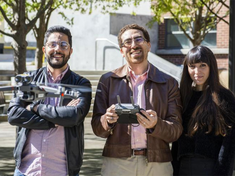 Photo of School of Architecture faculty flying a drone.