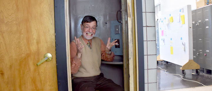 Gary Cornell sits in the phone booth on the third floor of the East Architecture building.