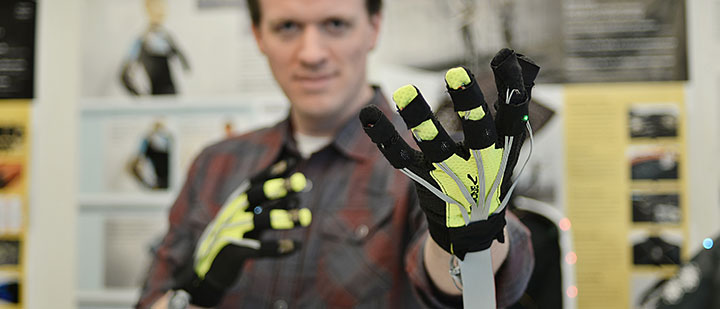 James Hallam from the Interactive Product Development Lab displays the haptic gloves he invented.