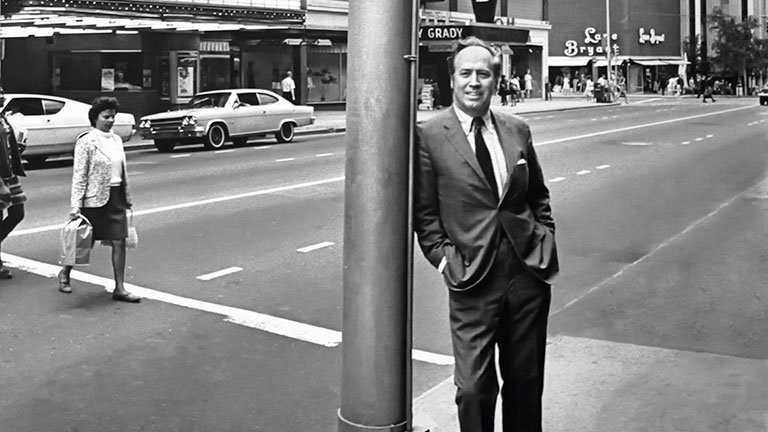 John Poirtman leans against a lamp pole in downtown Atlanta in 1968.
